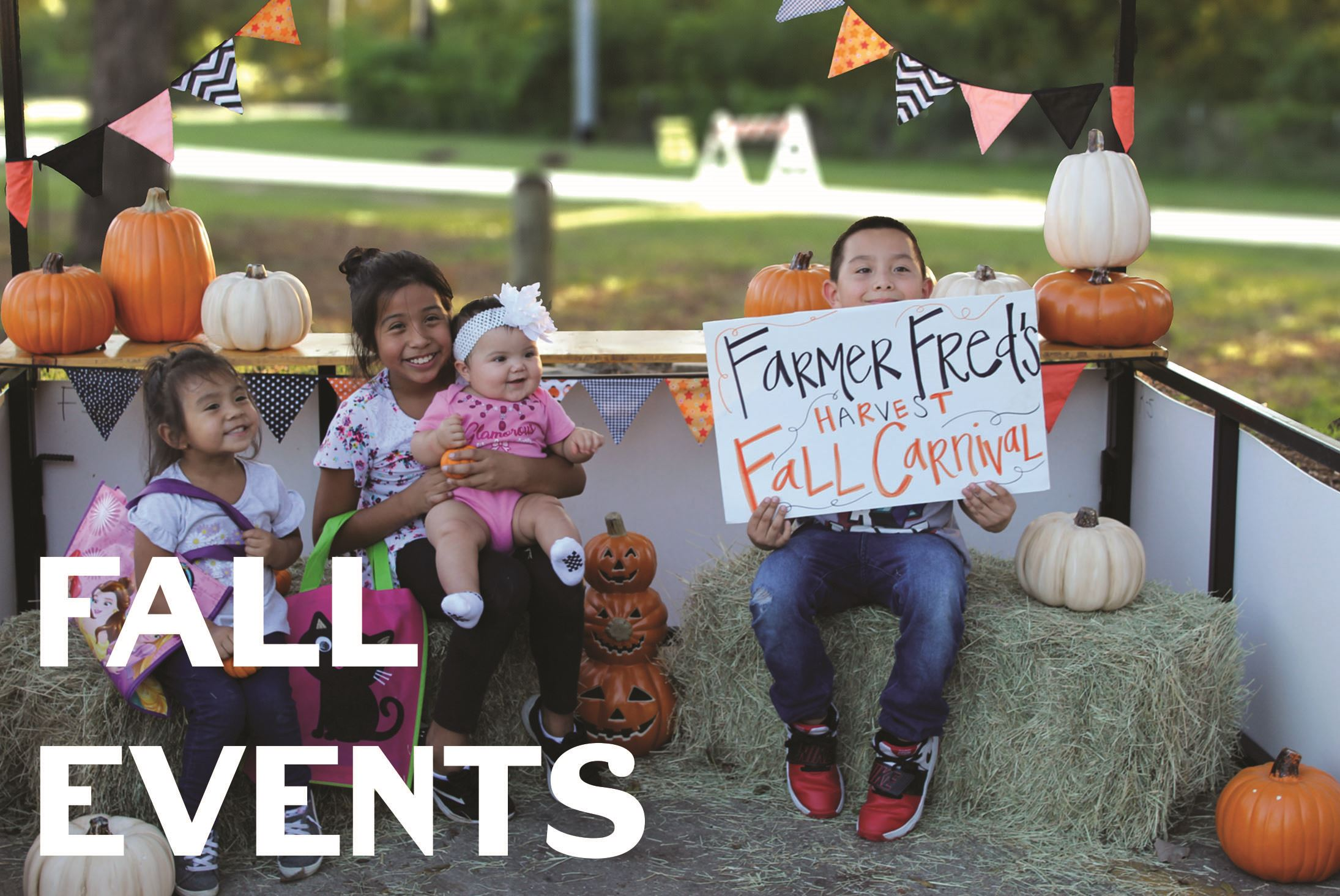 fall carnival image of children smiling with pumpkins